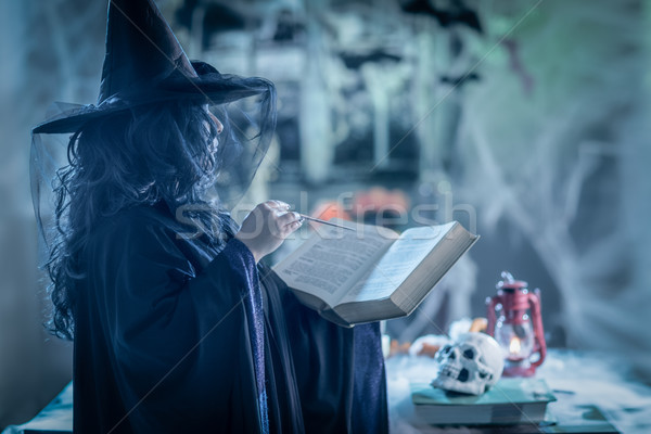 Stock photo: Witch With Magic Book