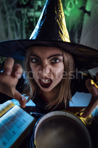 Young Witch Sends Evil Makes Stock photo © MilanMarkovic78
