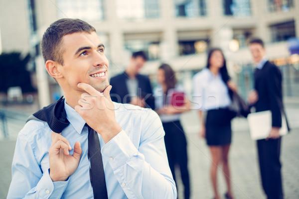 Młodych biznesmen portret myślenia stałego biurowiec Zdjęcia stock © MilanMarkovic78
