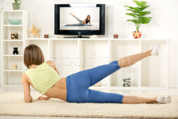 Woman Exercise In Front Of TV Stock photo © MilanMarkovic78