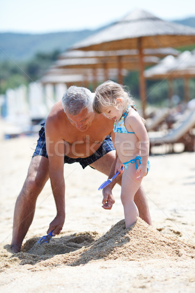 grandfather and granddaughter on the beach Stock photo © MilanMarkovic78