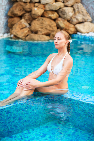 Woman relaxing in the pool at Spa center Stock photo © MilanMarkovic78