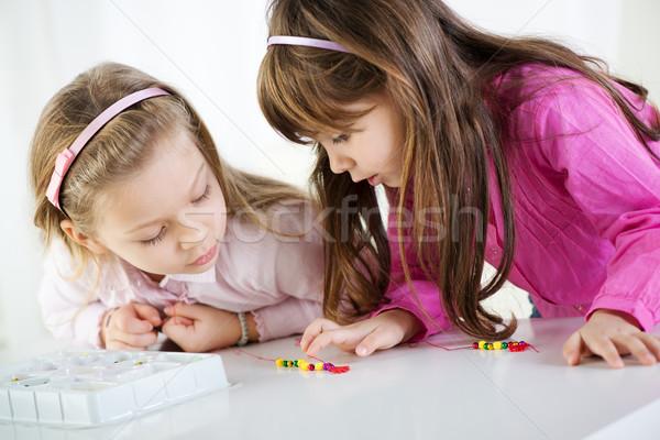 Aranyos kislányok kettő játszik otthon család Stock fotó © MilanMarkovic78