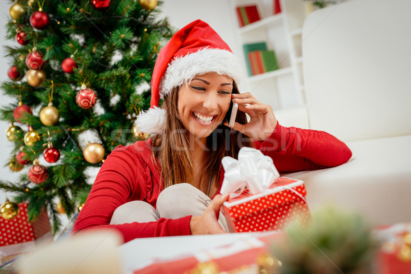 Girl With Santa's Hat And Smart Phone Stock photo © MilanMarkovic78