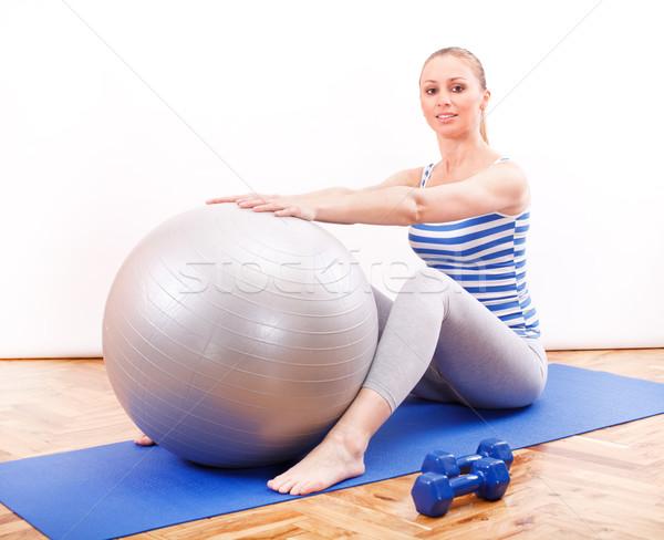 Pilates képzés fiatal nő labda ül kék Stock fotó © MilanMarkovic78