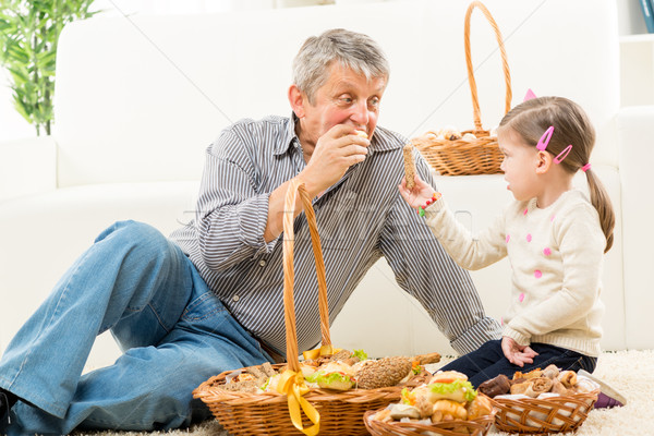 Grandfather And Granddaughter Eat Pastry Stock photo © MilanMarkovic78
