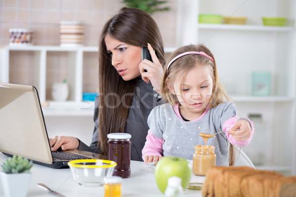 Overworked businesswoman at home Stock photo © MilanMarkovic78