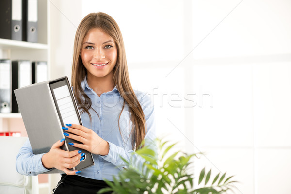 Young Businesswoman With Binder Stock photo © MilanMarkovic78