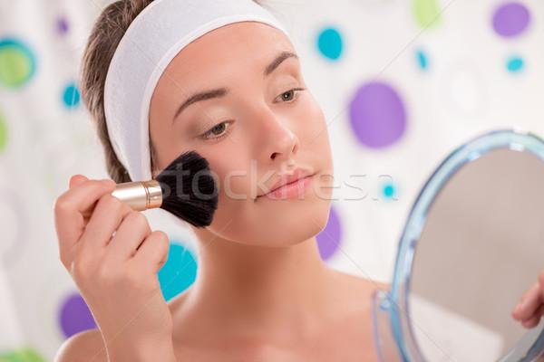 Cute Girl Applying Blush Stock photo © MilanMarkovic78