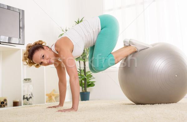 Mulher jovem pilates belo casa tv feliz Foto stock © MilanMarkovic78