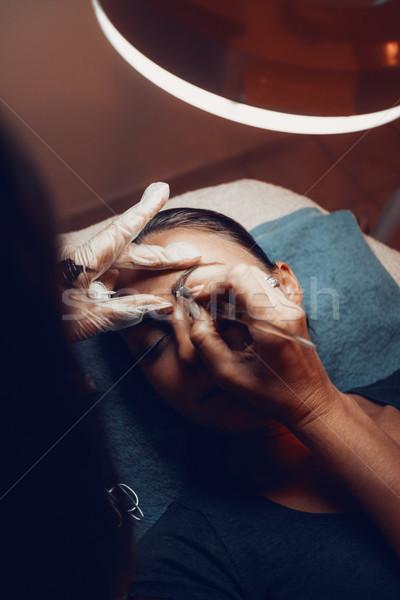 Szemöldök közelkép kezek jelentkezik szemöldök smink Stock fotó © MilanMarkovic78