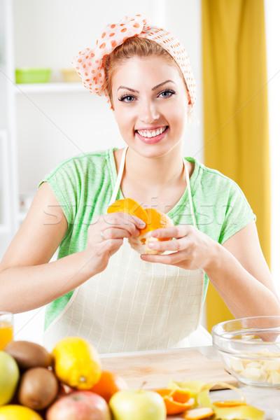 Young Woman Peeling Oranges. Stock photo © MilanMarkovic78