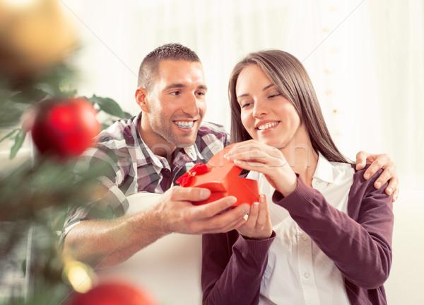 幸せ クリスマス カップル 若い男 ガールフレンド ギフト ストックフォト © MilanMarkovic78