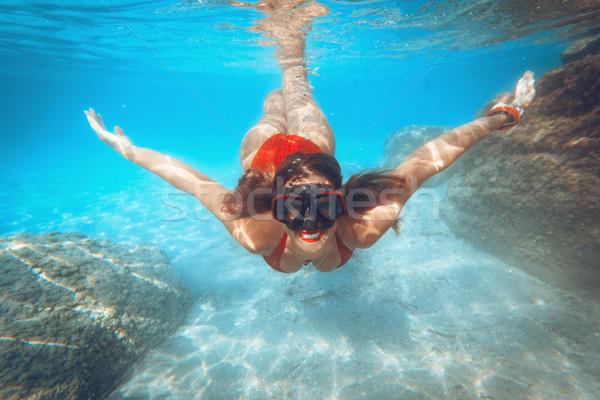 Vízalatti jókedv gyönyörű fiatal nő búvárkodik tenger Stock fotó © MilanMarkovic78