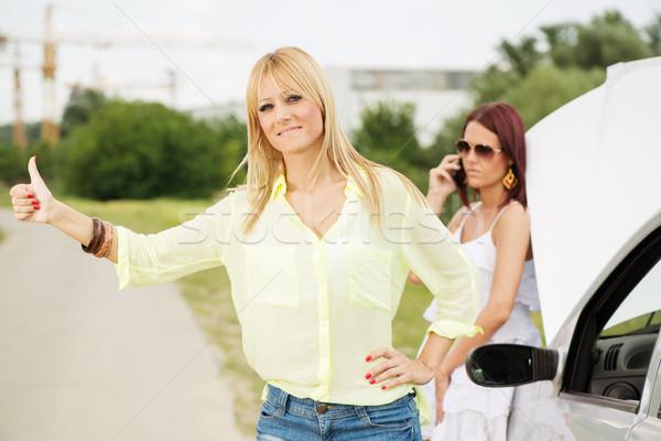 Yol iki genç turist kadın bekleme Stok fotoğraf © MilanMarkovic78