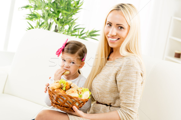 Cute Mom And Daughter With Pastries Stock photo © MilanMarkovic78