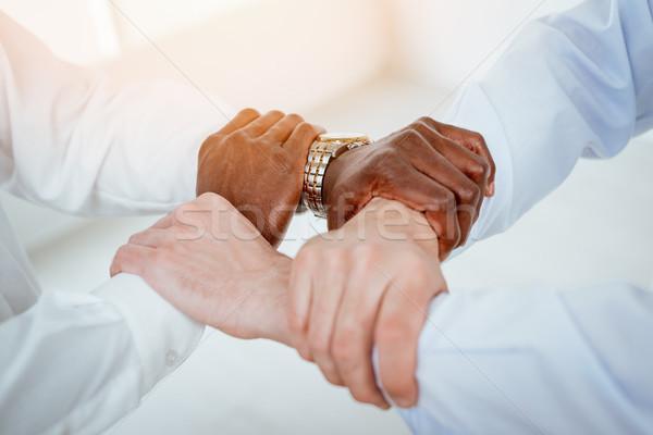 Siła jedność cztery czarno białe ręce Zdjęcia stock © MilanMarkovic78