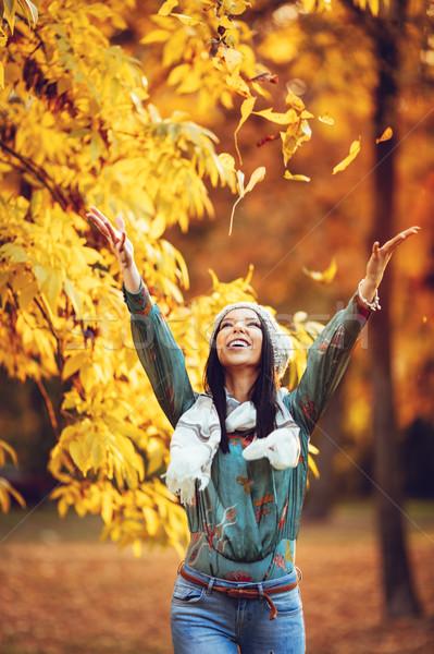 Happy Woman In Autumn Park Stock photo © MilanMarkovic78