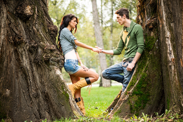Romance Beside A Tree Trunk Stock photo © MilanMarkovic78