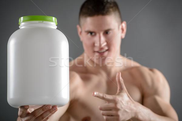 Ottimo alimentare bodybuilder muscolare uomo Foto d'archivio © MilanMarkovic78