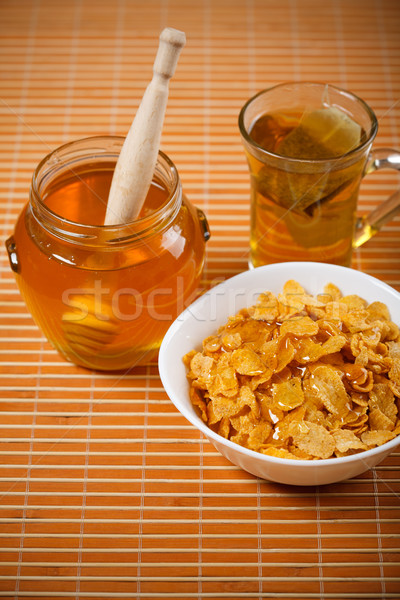 fresh honey, tea and breakfast flakes Stock photo © MilanMarkovic78