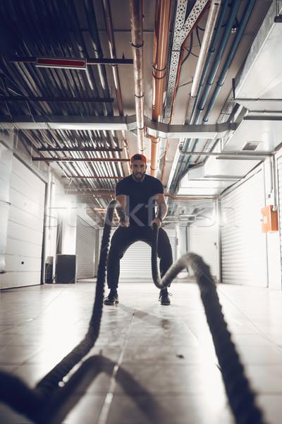 Crossfitの ロープ 訓練 ハンサム 筋肉の 若い男 ストックフォト © MilanMarkovic78