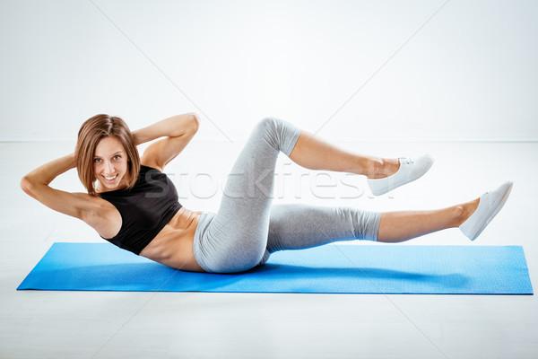 Determinado atraente mulher da aptidão exercer casa Foto stock © MilanMarkovic78