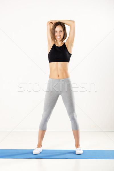 Lány nyújtás sportos nők sportok ruházat Stock fotó © MilanMarkovic78