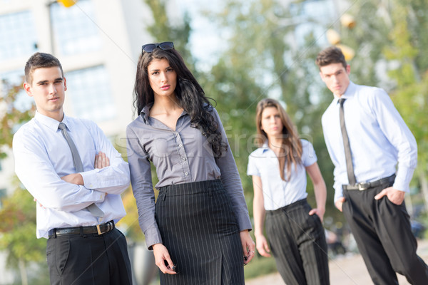 Gens d'affaires extérieur groupe jeunes permanent à l'extérieur Photo stock © MilanMarkovic78