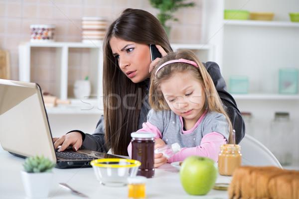 Oberati di lavoro imprenditrice home donna d'affari piccolo figlia Foto d'archivio © MilanMarkovic78
