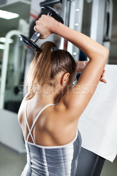 Triceps cute jeune femme exercice fitness Photo stock © MilanMarkovic78