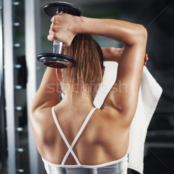 Triceps cute młoda kobieta wykonywania fitness Zdjęcia stock © MilanMarkovic78