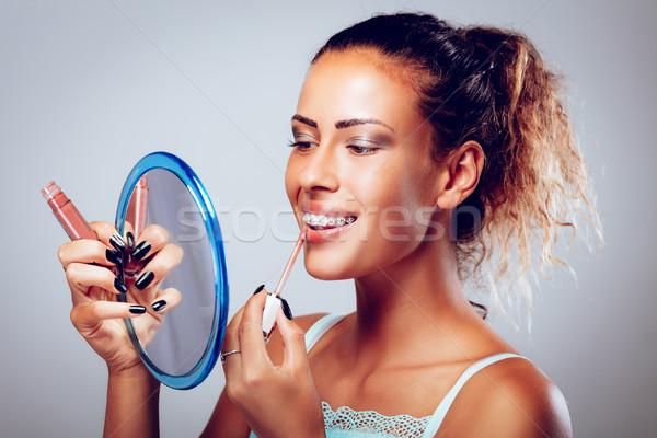 Mulher gloss sorridente mulher jovem suspensórios Foto stock © MilanMarkovic78