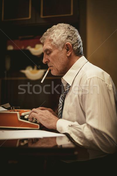 Retro idős férfi tél cigaretta száj Stock fotó © MilanMarkovic78