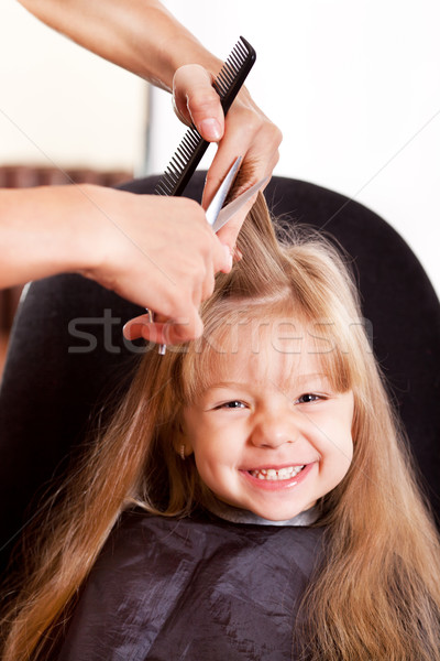 Happy little girl at the hairdresser Stock photo © MilanMarkovic78