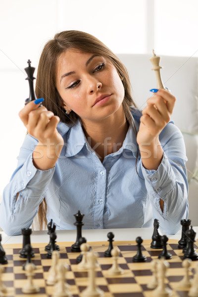 Young Pretty Businesswoman With Chess Pieces Stock photo © MilanMarkovic78
