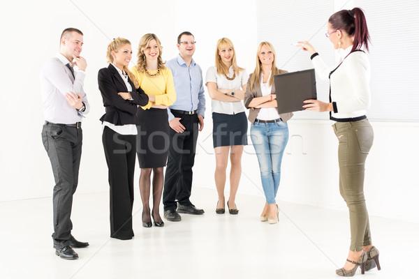Stock photo: Businesswoman Demonstrating Plan Of Work