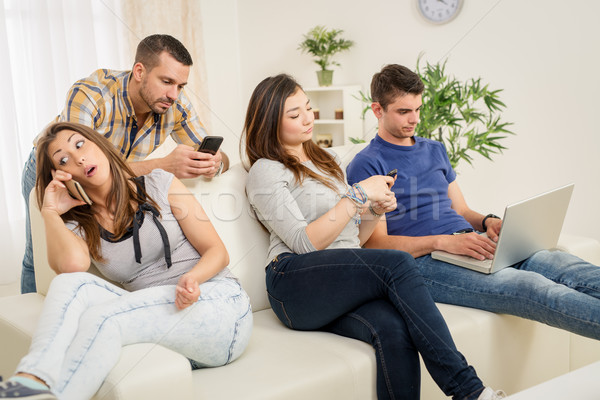 Friends Using Wireless Technology Stock photo © MilanMarkovic78