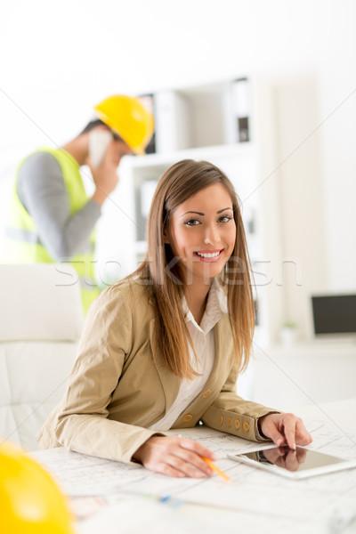 小さな 建築 笑みを浮かべて 女性 青写真 タブレット ストックフォト © MilanMarkovic78