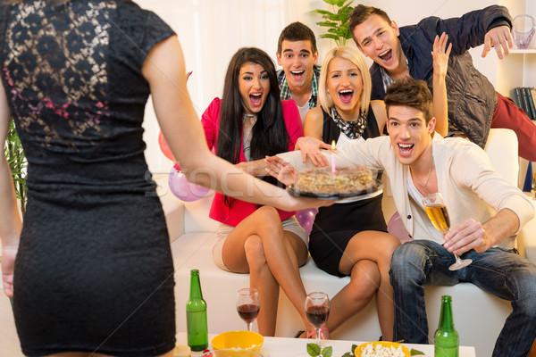 Niespodzianką mała grupa młodych ludzi znajomych domu urodziny Zdjęcia stock © MilanMarkovic78