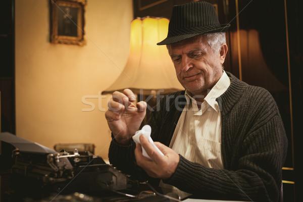 Bezorgd retro senior man schrijver bril Stockfoto © MilanMarkovic78