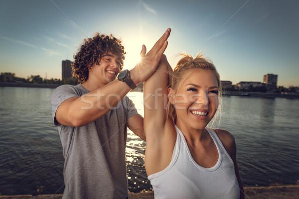 állandóan jobb együtt fiatal fitnessz pár Stock fotó © MilanMarkovic78