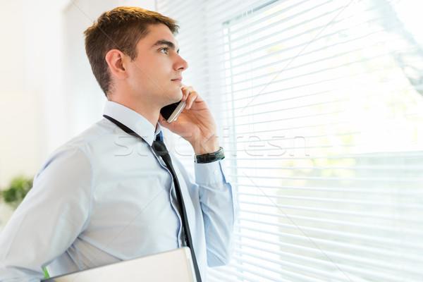 Businessman Using Phone Stock photo © MilanMarkovic78