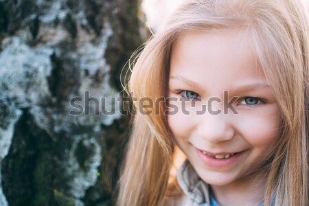 Little Girl With Blue Eyes Stock photo © MilanMarkovic78