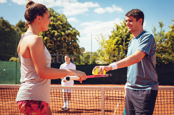 Young Couple Preparing To Serve On Tennis Match Stock photo © MilanMarkovic78