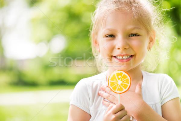 портрет Cute девочку леденец Постоянный парка Сток-фото © MilanMarkovic78