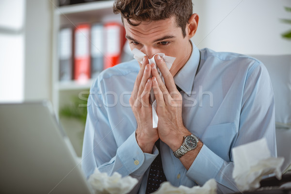 Soğuk grip genç işadamı burun çalışma Stok fotoğraf © MilanMarkovic78