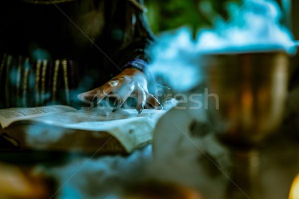Mão magia livro preto unhas Foto stock © MilanMarkovic78