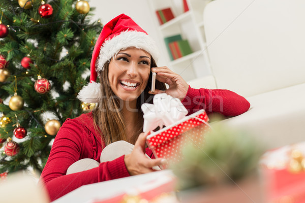Girl With Christmas Present And Smart Phone Stock photo © MilanMarkovic78
