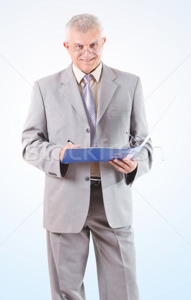 Mosolyog sikeres idős üzletember aláírás iratok Stock fotó © MilanMarkovic78